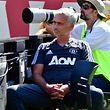 Manchester United manager Jose Mourinho sits in the photographer area during the penalty kicks
