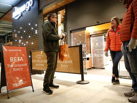 Amazon employees are pictured outside the Amazon Go brick-and-mortar grocery store without lines or checkout counters, in Seattle Washington, U.S. December 5, 2016. REUTERS/Jason Redmond