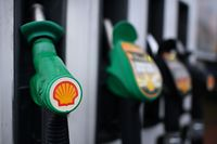 (FILES) In this file photo taken on January 30, 2018 the logo of energy giant Royal Dutch Shell is pictured on pumps at a petrol station in London. Royal Dutch Shell said on February 1, 2018 that profit after taxation almost tripled to just under $13 billion (10.5 billion euros) in 2017, energised by rising oil and gas prices.  / AFP PHOTO / BEN STANSALL