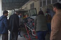 A wounded Afghan man is wheeled on a stretcher at the Wazir Akbar Khan hospital, after a car bomb attack, in Kabul on December 24, 2018. - Militants detonated a car bomb before storming a Kabul government compound in an ongoing attack on December 24, officials and witnesses said, in the latest violence to rock the Afghan capital. A number of gunmen have entered the compound where the Ministry of Public Works and an office of the Ministry of Labor, Social Affairs, Martyrs and Disabled are located, interior ministry deputy spokesman Nasrat Rahimi said. (Photo by WAKIL KOHSAR / AFP)