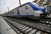 (FILES) This file photo taken on April 3, 2018 in Saint-Charles railway station in Marseille southern France shows a TER (Transport express regional) train at the start of three months of rolling rail strikes. - Staff at French state rail operator SNCF's regional network walked off the job on October 18, 2019 following an accident in Champagne-Ardenne region as a regional TER (Transport express regional) train struck a lorry, injuring three. (Photo by BERTRAND LANGLOIS / AFP)