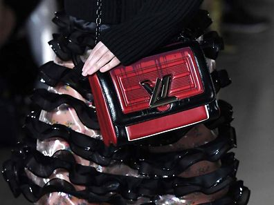 A model presents a handbag by Louis Vuitton for the women's Fall-Winter ready-to-wear collection fashion show at the Louvre Museum in Paris on March 7, 2017.  / AFP PHOTO / bertrand GUAY