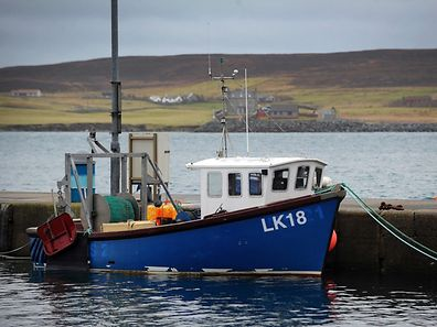 A fishing boat sits moored at Lerwick Harbour in Lerwick, Shetland Islands, on February 1, 2017. In the fishing ports of the remote Shetland Islands off northern Scotland, hopes are high that Brexit could boost a once-thriving industry. The Shetlands, along with Scotland's Western Isles, were the only part of the United Kingdom that voted against joining what was then the European Economic Community in a 1975 referendum. / AFP PHOTO / ANDY BUCHANAN