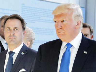 U.S. President Donald Trump (R) and Luxembourg's Prime Minister Xavier Bettel (2ndR) walk past Britain's Prime Minster Theresa May before the start of the NATO summit at their new headquarters in Brussels, Belgium, May 25, 2017.    REUTERS/Kevin Coombs