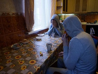 Chechen gay men who fled persecution in their home Russia's Muslim region of Chechnya due to his sexual-orientation, sits around a table in their flat in Moscow on April 17, 2017. / AFP PHOTO / Naira DAVLASHYAN / TO GO WITH AFP STORY BY Anais LLOBET