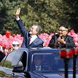 "North Korean leader Kim Jong Un (R) and South Korean President Moon Jae-in (L) wave to Pyongyang citizens from an open-topped as they drive through Pyongyang on September 18, 2018. - South Korea's president and the North's leader Kim Jong Un drove through the streets of Pyongyang together past thousands of cheering citizens on September 18, ahead of a summit where Moon Jae-in will seek to reboot stalled denuclearisation talks between North Korea and the United States. (Photo by - / Pyeongyang Press Corps / AFP) / RESTRICTED TO EDITORIAL USE - MANDATORY CREDIT ""AFP PHOTO / Pyeongyang Press Corps"" - NO MARKETING NO ADVERTISING CAMPAIGNS - DISTRIBUTED AS A SERVICE TO CLIENTS"