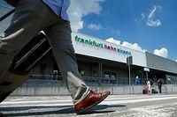 A passenger walks past the terminal of Frankfurt Hahn airport 100 kilometers (60 miles) west of Frankfurt, Germany June 6, 2016.  REUTERS/Ralph Orlowski