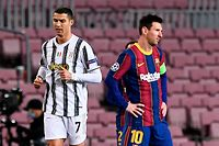 Juventus' Portuguese forward Cristiano Ronaldo (L) walks past Barcelona's Argentinian forward Lionel Messi during the UEFA Champions League group G football match between Barcelona and Juventus at the Camp Nou stadium in Barcelona on December 8, 2020. (Photo by Josep LAGO / AFP)