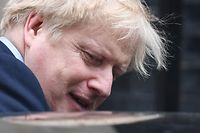 Britain's Prime Minister Boris Johnson leaves 10 Downing Street in central London on February 26, 2020, to take part in Prime Minister's Questions (PMQs) at the House of Commons. (Photo by DANIEL LEAL-OLIVAS / AFP)