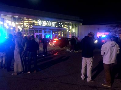 This image from video provided by KSTP 5 television in Minneapolis, Minnesota, shows people standing outside the scene of a stabbing at the Crossroads Center mall