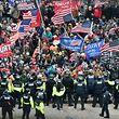 Trump supporters clash with police and security forces as they storm the US Capitol in Washington, DC on January 6, 2021. - Donald Trump's supporters stormed a session of Congress held today, January 6, to certify Joe Biden's election win, triggering unprecedented chaos and violence at the heart of American democracy and accusations the president was attempting a coup. (Photo by Olivier DOULIERY / AFP)