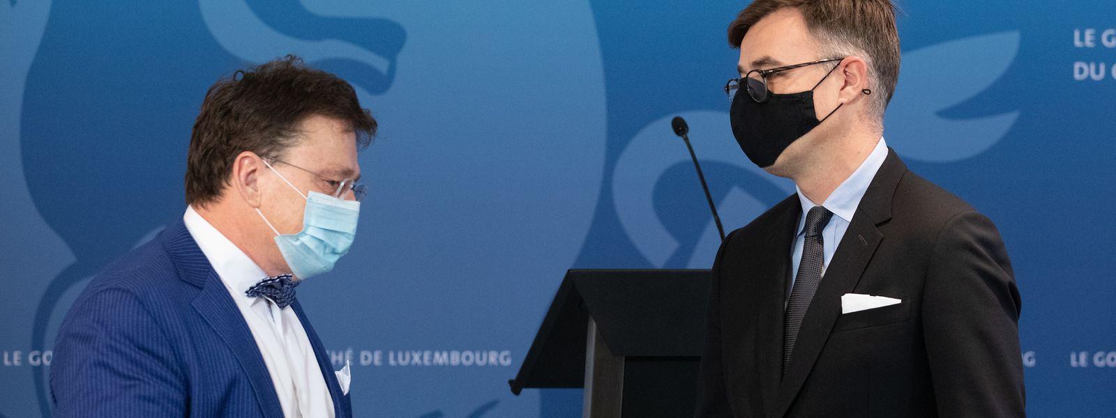 Wirtschaftsminister Franz Fayot (r.) und Serge Allegrezza bei der Vorstellung des Wettbewerbsberichtes 2020.