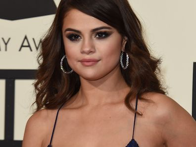 Singer Selena Gomez arrives on the red carpet during the 58th Annual Grammy Music Awards in Los Angeles February 15, 2016. AFP PHOTO/ Valerie MACON / AFP PHOTO / VALERIE MACON