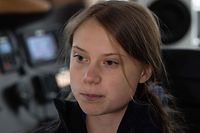 """Swedish climate activist Greta Thunberg speaks to AFP during an interview aboard La Vagabonde, the boat she will be taking to return to Europe, in Hampton, Virginia, on November 12, 2019. - Swedish teen activist Greta Thunberg said November 12, 2019 that US President Donald Trump's climate change denialism was """"so extreme"""" that it had helped galvanize the movement to halt long term planetary warming. (Photo by NICHOLAS KAMM / AFP)"""