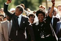 FILE -- In this Sunday, Feb. 11, 1990 file photo, Nelson Mandela and wife Winnie, walk hand-in hand-with their raised clenched fists upon Mandela's release from Victor Verster prison, near Cape Town South Africa. Mandela never met with Martin Luther King Jr but the two fought for the same issues at the same time on two different continents. Mandela said in a 1964 speech that he was prepared to die to see his dream of a society where blacks and whites were equal become reality. King was killed by an assassin's bullet while working for that same dream. ( (AP Photo/Greg English, File)