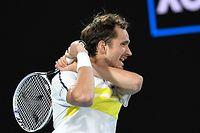 Russia's Daniil Medvedev hits a return against Greece's Stefanos Tsitsipas during their men's singles semi-final match on day twelve of the Australian Open tennis tournament in Melbourne on February 19, 2021. (Photo by William WEST / AFP) / -- IMAGE RESTRICTED TO EDITORIAL USE - STRICTLY NO COMMERCIAL USE --