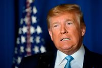 "(FILES) In this file photo taken on January 3, 2020, US President Donald Trump makes a statement on Iran at the Mar-a-Lago estate in Palm Beach Florida. - President Donald Trump warned on January 4, 2020 that the US is targeting 52 sites in Iran and will hit them ""very fast and very hard"" if the Islamic republic attacks American personnel or assets. In a sabre-rattling tweet that defended Friday's US drone strike assassination of a powerful Iranian general in Iraq, Trump said 52 represents the number of Americans held hostage at the US embassy in Tehran for more than a year starting in late 1979. (Photo by JIM WATSON / AFP)"