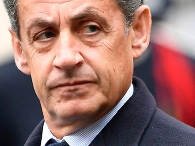 Former French President Nicolas Sarkozy (L) and former French Prime Minister, Jean-Pierre Raffarin attend a ceremony honouring the policeman killed by a jihadist in an attack on the Champs Elysees, on April 25, 2017 at the Paris prefecture building. French police officer Xavier Jugele was killed on the world-famous Paris avenue on April 20, in an attack claimed by the Islamic State group.  / AFP PHOTO / bertrand GUAY