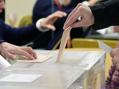A man casts his vote at the Volturno Cultural Centre in Pozuelo de Alarcon on the outskirts of Madrid on December 20, 2015. Spaniards go to the polls today in what is expected to be one of the most closely-fought contests in modern history, as two dynamic new parties take on the country's long-established giants. AFP PHOTO / JAVIER SORIANO