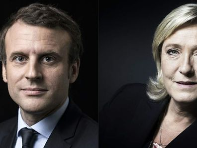 A combination of pictures made on April 23, 2017 shows French presidential election candidate for the En Marche ! movement Emmanuel Macron (L) and French presidential election candidate for the far-right Front National (FN) party Marine Le Pen (R) posing in Paris. Far-right leader Marine Le Pen and centrist Emmanuel Macron were on course April 23 to qualify for the runoff in France's presidential election, initial projections suggested.  / AFP PHOTO / Eric FEFERBERG AND JOEL SAGET