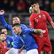 (From L) Italy's midfielder Marco Verratti, Italy's defender Cristiano Biraghi and Portugal's defender Joao Cancelo go for a header during the UEFA Nations League group 3 football match Italy vs Portugal at the San Siro Stadium in Milan on November 17, 2018. (Photo by Marco BERTORELLO / AFP)