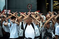 "(FILES) In this file picture taken on June 9, 2019, protesters gesture as they chant ""no extradition"" as they rally against a controversial extradition law proposal in Hong Kong. - Hong Kong on June 9, 2020 marks a year since pro-democracy protests erupted, but a resumption of city-wide unrest is unlikely as activists reel from mass arrests, coronavirus bans on public gatherings and a looming national security law. (Photo by PHILIP FONG / AFP)"