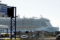 The Costa Smeralda cruise ship (L) is docked in the Civitavecchia port 70km north of Rome on January 30, 2020. More than 6,000 tourists were under lockdown aboard the cruise ship after two Chinese passengers were isolated over fears they could be carrying the coronavirus. - Samples from the two passengers were sent for testing after three doctors and a nurse boarded the Costa Crociere ship in the port of Civitavecchia to tend to a woman running a fever, the local health authorities said. (Photo by Filippo MONTEFORTE / AFP)