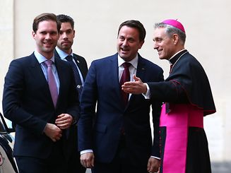 Archbishop Georg Ganswein greets Luxembourg Prime Minister Xavier Bettel (C) and his husband Gauthier Destenay as they arrive for a meeting with Pope Francis at the Vatican March 24, 2017.  REUTERS/Alessandro Bianchi