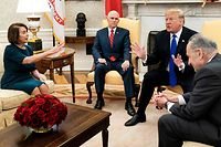 US Vice President Mike Pence (2L) listens while presumptive Speaker, House Minority Leader Nancy Pelosi (D-CA) (L), US President Donald Trump (2R) and Senate Minority Leader Charles E. Schumer (D-NY) argue before a meeting at the White House December 11, 2018 in Washington, DC. (Photo by Brendan Smialowski / AFP)