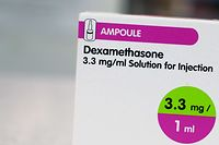 """A box of dexamethasone injection ampoules is photographed at a chemists shop in London on June 16, 2020. - The steroid dexamethasone was shown Tuesday to be the first drug to significantly reduce the risk of death among severe COVID-19 cases, in trial results hailed as a """"major breakthrough"""" in the fight against the disease. (Photo by Arman SOLDIN / AFP)"""