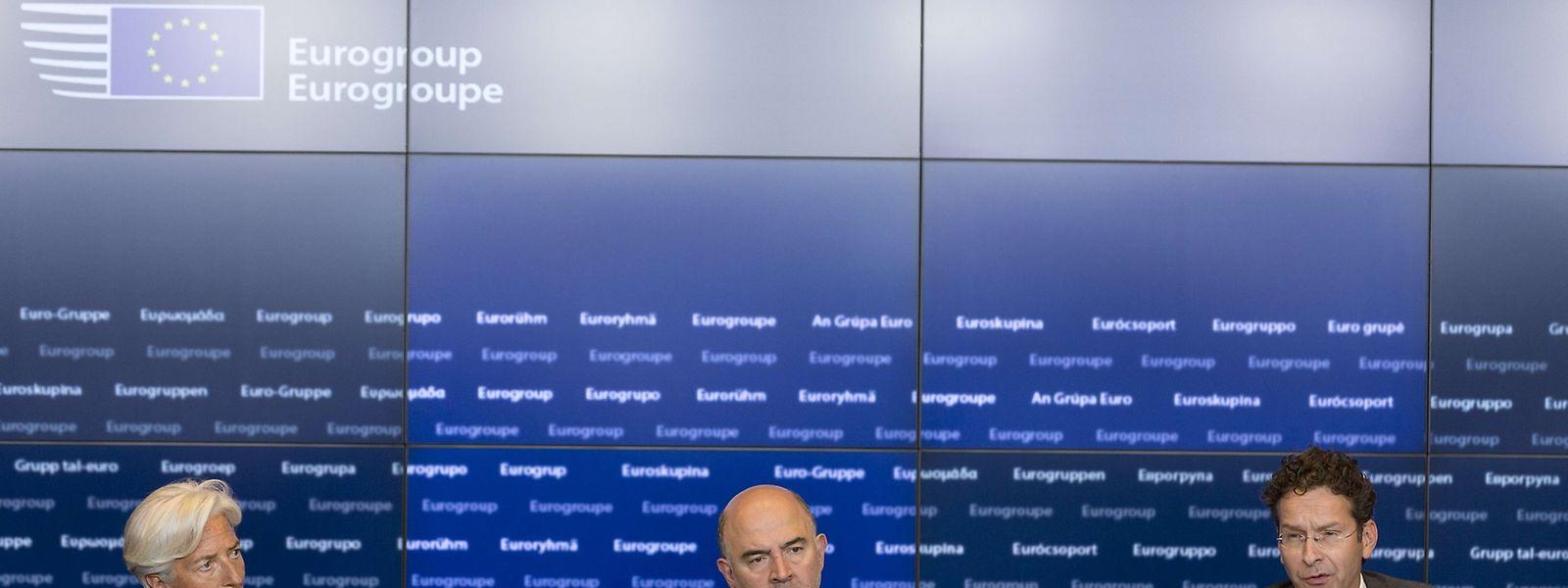 Christine Lagarde (IWF), Pierre Moscivici (EU-Kommission) undJeroen Dijsselbloem (Eurogruppe) bei ihrer gemeinsamen Erklärung.