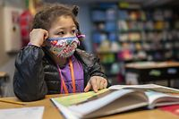 WOODLAND, WA - FEBRUARY 18: A first grade student at the Green Mountain School listens to her teacher on February 18, 2021 in Woodland, Washington. Washington state loosened in-person learning guidelines in December, sending elementary and middle school students back to the classroom a few days each week.   Nathan Howard/Getty Images/AFP == FOR NEWSPAPERS, INTERNET, TELCOS & TELEVISION USE ONLY ==