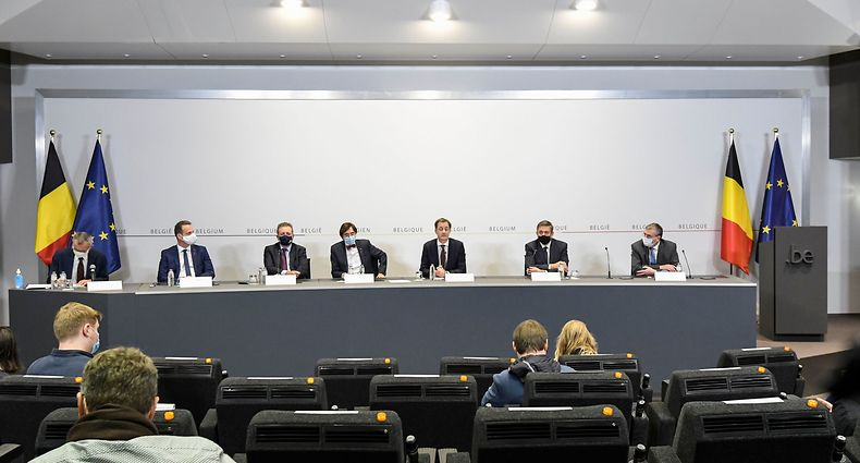 (L-R) Belgium's Vice-Prime Minister and Public Health and Social Affairs minister Frank Vandenbroucke, German Community Minister President Oliver Paasch, Brussels Region Minister-President Rudi Vervoort, Walloon Minister President Elio Di Rupo, Prime Minister Alexander De Croo, Flemish Minister President Jan Jambon and Federation Wallonia - Brussels Minister President Pierre-Yves Jeholet give a press conference following a meeting of the consultative committee with ministers of the Federal government, the regional governments and the community governments, focused on the Covid-19 (novel coronavirus) outbreak, in Brussels, on October 30, 2020. - Belgium, the country with by some measures the world's worst coronavirus outbreak, will impose tighter lockdown rules from November 2, closing non-essential businesses and restricting household visits. (Photo by Philip REYNAERS / BELGA / AFP) / Belgium OUT