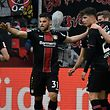 (L-R) Leverkusen's Austrian midflielder Julian Baumgartlinger, Leverkusen's German forward Kevin Volland and Leverkusen's German midfielder Kai Havertz celebrate after their team scored the 4-1 during the German first division Bundesliga football match Bayer Leverkusen vs Eintracht Frankfurt in Leverkusen, western Germany on May 5, 2019. (Photo by INA FASSBENDER / AFP) / RESTRICTIONS: DFL REGULATIONS PROHIBIT ANY USE OF PHOTOGRAPHS AS IMAGE SEQUENCES AND/OR QUASI-VIDEO