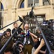 Jean-Christophe Tymoczko (C), the lawyer of the key witness' cousin, addresses the media outside the courthouse of Dijon on July 28, 2017. Murielle Bolle, a key witness in the Gregory case, was to be confronted on July 28, 2017 with her cousin whose revelations were decisive in her recent incarceration, restarting the investigation into the murder of the four-year-old Gregory Villemin in 1984, 32 years after the events. Investigators involved in the case today want in particular to find out why Bolle went back on her original accusations, and last month she herself was placed under investigation in the case. / AFP PHOTO / JEAN-PHILIPPE KSIAZEK