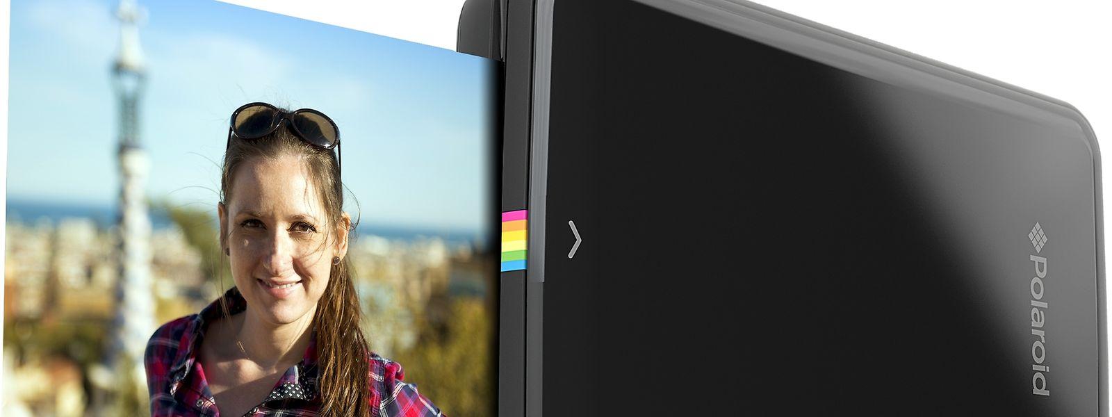 Klick! Drucken, fertig. Mit dem Polaroid Zip photoprinter können unterwegs Fotos ausgedruckt werden.