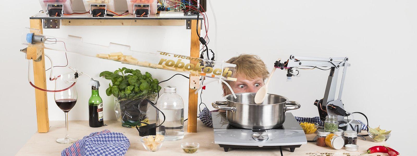 Wissenschaftsjournalist Jakob Vicari und sein Kochroboter.