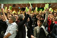 "Werner Kogler (L), leader of the Austrian Green party, and delegates hold up their voting cards during the Greens' party congress on January 4, 2020 in Salzburg. - The delegates of the Greens voted on Austria's first coalition between conservatives (OeVP) and Greens. The two disparate parties have agreed to govern in what Greens leader Werner Kogler called a ""gamble"" after key election gains in September 2019. Their alliance means People's Party (OeVP) leader Sebastian Kurz, 33, returns as chancellor after his previous coalition with the far-right broke apart earlier this year owing to a corruption scandal. It marks the first time the Greens enter government on a national level though the OeVP holds on to controversial anti-immigration measures that have deeply divided Austrians. (Photo by BARBARA GINDL / APA / AFP) / Austria OUT"