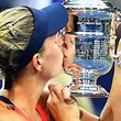NEW YORK, NY - SEPTEMBER 10: Angelique Kerber of Germany kisses the trophy after winning (6-3), (4-6), (6-4) against Karolina Pliskova of the Czech Republic in their Women's Singles Final Match on Day Thirteen of the 2016 US Open at the USTA Billie Jean King National Tennis Center on September 10, 2016 in the Flushing neighborhood of the Queens borough of New York City.   Alex Goodlett/Getty Images/AFP == FOR NEWSPAPERS, INTERNET, TELCOS & TELEVISION USE ONLY ==