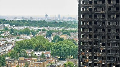 "The charred remains of clading are pictured on the outer walls of the burnt out shell of the Grenfell Tower block in north Kensington, west London on June 22, 2017. Combustible cladding has been found in ""a number"" of publicly-owned tower blocks in Britain following emergency checks ordered after the June 14 devastating fire at Grenfell Tower, British Prime Minister Theresa May said Thursday. ""A number of these tests have come back as combustible,"" May said in a statement to parliament after ordering checks on all similar blocks. / AFP PHOTO / NIKLAS HALLE'N"