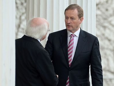 """Irish Prime Minister, Enda Kenny (R), shakes hands with Irish President Michael Higgins, after signing a proclamation formally dissolving parliament at Aras an Uachtarain, the official residence of the President, in Dublin, Ireland on February 3, 2016. Kenny called parliamentary elections for February 26, in a poll that could see disillusioned voters turn away from established parties to back political mavericks. """"I am seeking a dissolution of Dail Eireann (parliament) today with the election to be held on February 26th,"""" Kenny tweeted before going to President Michael Higgins for formal authorisation. / AFP / Caroline Quinn"""