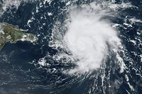 "This satellite image obtained from NOAA/RAMMB, shows Tropical Storm Dorian as it approaches Puerto Rico in the Caribbean at 17:0 UTC on August 28, 2019. - Tropical Storm Dorian bore down on Puerto Rico Wednesday as residents braced for a direct hit, the first since the island was ravaged two years ago by Hurricane Maria.Even before the hurricane hit, an 80-year-old man was killed in a fall from a ladder while fixing a roof in a San Juan suburb, police said. US forecasters said they expected Dorian to make landfall in populous eastern Puerto Rico at near hurricane strength later in the day. A hurricane watch was also in effect for the US Virgin Islands. (Photo by HO / NOAA/RAMMB / AFP) / RESTRICTED TO EDITORIAL USE - MANDATORY CREDIT ""AFP PHOTO / NOAA/RAMMB/HANDOUT"" - NO MARKETING - NO ADVERTISING CAMPAIGNS - DISTRIBUTED AS A SERVICE TO CLIENTS"