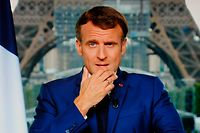 French President Emmanuel Macron is seen on a TV screen as he speaks during a televised address to the nation from the temporary Grand Palais in Paris on July 12, 2021. (Photo by Ludovic MARIN / AFP)