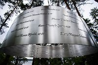 (FILES) In this file photo taken on August 05, 2015 The memorial reading the names of the slaughtered Norwegian Labour party youth (AUF) activists is seen on the Utoya island some 40 km west of Oslo on August 5, 2015, ahead of their first summer camp since the bloody rampage in 2011. - Norway was plunged into horror on July 22, 2011, when right-wing extremist Anders Behring Breivik killed dozens in a bomb attack in central Oslo and a shooting spree on the island of Utoya. (Photo by Odd ANDERSEN / AFP)