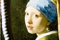 (FILES) In this file photo taken on february 26, 2018 hows Johannes Vermeer's �Girl with a Pearl Earring� painting inside a XRF macro-scanner during a research at The Mauritshuis in The Hague. - New researches carried out on Vermeer's ''Girl with the Pearl Earring'', one of the most famous paintings in the world, has unveiled discoveries that makes it more 'personal' even if the identity of the woman still remains a mystery, announced the museum on April 28, 2020. (Photo by Bart MAAT / ANP / AFP) / Netherlands OUT