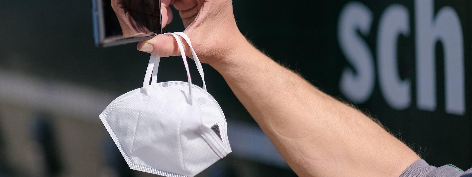 Die WHO warnt vor einer zusätzlichen Infektionsgefahr beim Abnehmen der Mundschutzmasken.