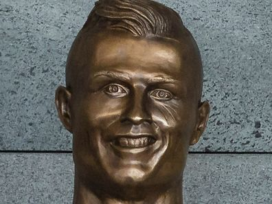 Ronaldo bust in the Madeira Airport was is after him during a naming event at Madeira's airport in Santa Cruz, Madeira island, Portugal, 29 March 2017. The Madeira International Airport was offically named to Cristiano Ronaldo Airport in honour to Cristiano Ronaldo who was born and raised on Madeira. GREGORIO CUNHA/LUSA