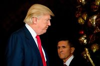 (FILES) In this file photo taken on December 21, 2016 US President-elect Donald Trump (L) stands with former Trump National Security Adviser Lt. General Michael  Flynn (R) at Mar-a-Lago in Palm Beach, Florida. - The Washington appeals court ordered false-statement charges against President Donald Trump's former national security advisor Michael Flynn to be dropped June 24, 2020, handing the White House a victory in a case that was central to the Russia meddling investigation. The court endorsed Attorney General Bill Barr's extraordinary decision to drop charges against Flynn even after he had twice pleaded guilty to lying to FBI investigators, overruling a lower court judge who was ready to sentence Flynn. (Photo by JIM WATSON / AFP)
