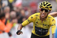 TOPSHOT - Colombia's Egan Bernal, wearing the overall leader's yellow jersey celebrates as he crosses the finish line of the twentieth stage of the 106th edition of the Tour de France cycling race between Albertville and Val Thorens, in Val Thorens, on July 27, 2019. (Photo by Marco Bertorello / AFP)