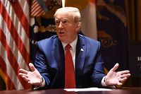 US President Donald Trump speaks during a meeting with the Governors of Colorado and North Dakota on May 13, 2020, in the Cabinet Room of the White House in Washington, DC. (Photo by Brendan Smialowski / AFP)